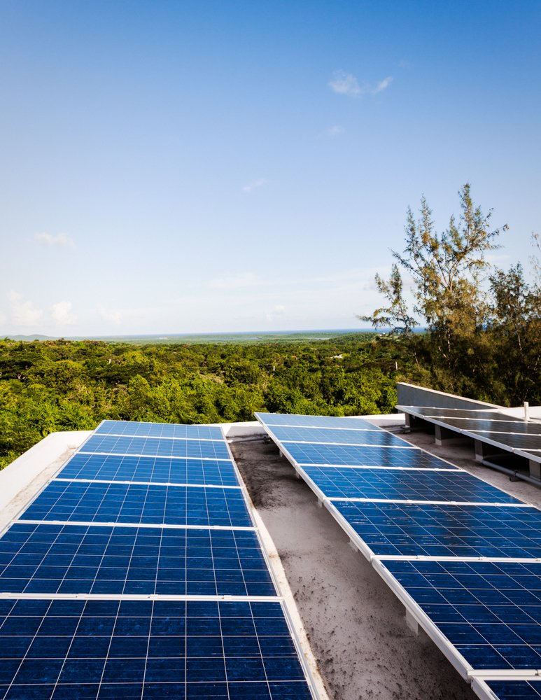 """On the roof, Casa Solaris has 24 solar panels, which feed to 12 batteries in what the architect calls """"the engine room,"""" plus two 50-gallon, solar hot water heaters, which feed to the sinks and outdoor showers. Photo by Michael Grimm.  Photo 9 of 9 in Modern Concrete Getaway in Paradise"""