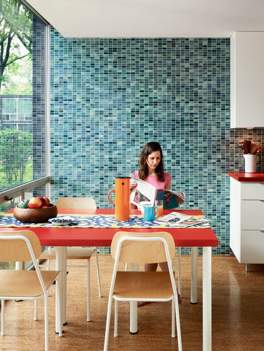Because the original kitchen had been removed, Alexandra made the decision to widen the gallery-style room by ten inches. Floor-to-ceiling glass makes for ample natural light in the eating area, while the Vitra wall tiles provide a contemporary touch.  Photo 3 of 3 in How to Tile a Wall