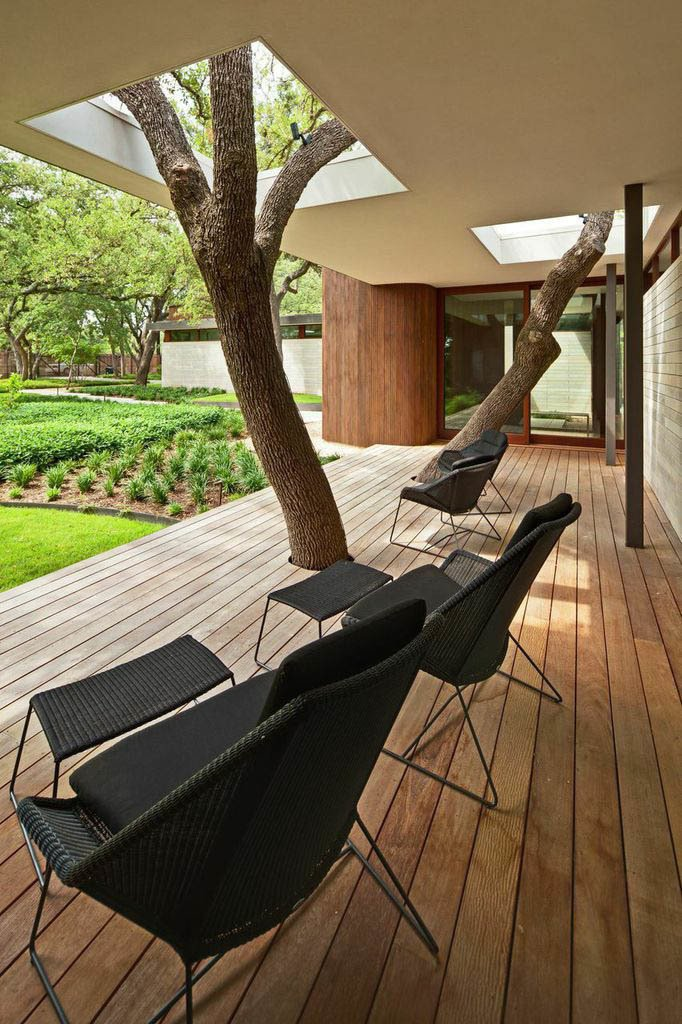 Outdoor, Small Patio, Porch, Deck, and Wood Patio, Porch, Deck The clients insisted that none of the trees on the property be disturbed, so Kevin Alter and his team at Alterstudio Architecture built a deck and an overhang around two of them.  Photo 2 of 7 in A Sensitive Modern House in Austin, Texas