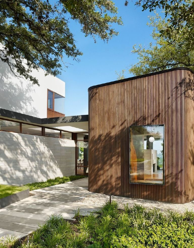 Outdoor, Walkways, and Side Yard In consultation with the clients, Alterstudio opted to clad the house in local cypress rather than imported, FSC-certified ipe.  Photo 4 of 7 in A Sensitive Modern House in Austin, Texas