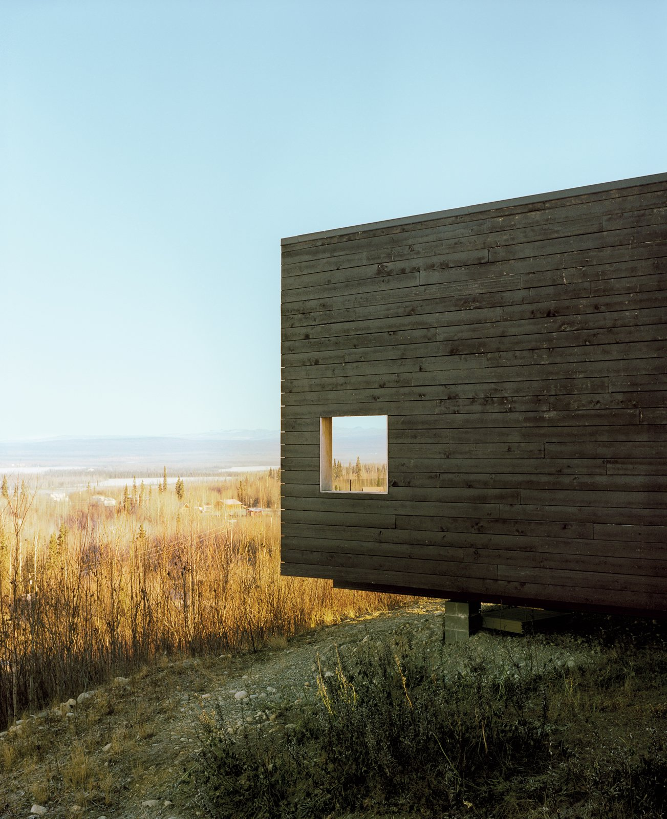 Exterior, Wood Siding Material, Cabin Building Type, and Flat RoofLine The charred cedar exterior gently basks in the Alaskan sun.  Photo 29 of 101 in 101 Best Modern Cabins