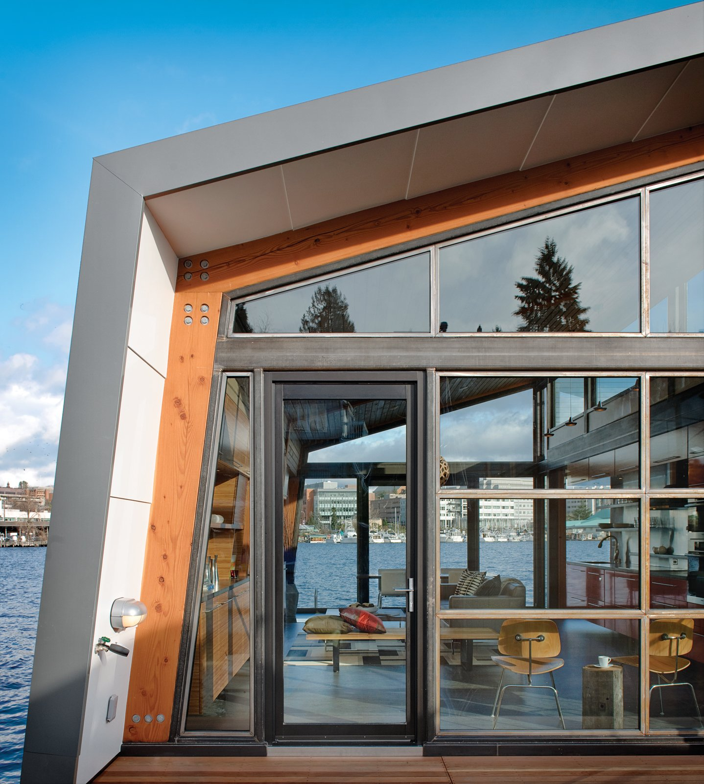"""I love being close to the water. There's constant change, with boats and wildlife passing by,"" says Denise Draper about her floating home on Seattle's Portage Bay. Read the story on the renovation 10 years in the making here.  Photo 2 of 2 in A Renovated Boathouse on Seattle's Portage Bay"