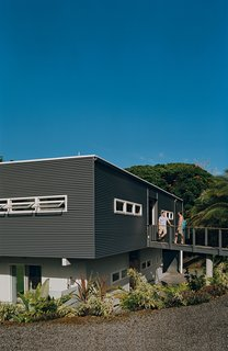 "Although their plan was to order a bamboo kit house or have a contractor build a simple ""kitschy island hut"" at a nearby construction site, Mike Kurokawa and Paul Fishman ended up recruiting Craig Steely to execute something of a miniature Hawaiian Case Study program. He discovered not only how to navigate the execution of a modern home in remote Puna, but also how to design for the extremes of the region's climate. Corrugated siding usually used for roofing is used for the exterior."