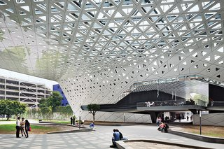 Rojkind Arquitectos is Transforming Mexico City, One Whimsical Building at a Time - Photo 2 of 10 - They consolidating surface parking in a new garage and uniting the campus with a canopy whose composite-aluminum skin is dappled with triangular perforations.