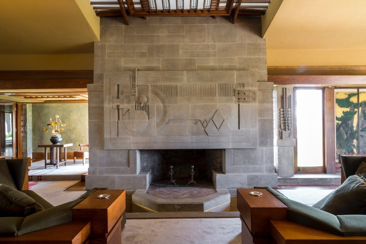 """The living room's original block fireplace. Hollyhock House is now on the tentative list of the first modern architecture nominations from the United States to the United Nation's Educational, Scientific, and Cultural Organization (UNESCO) World Heritage List. """"Frank Lloyd Wright's Hollyhock House is a crown jewel of Los Angeles architecture,"""" Mayor Garcetti says.  Photo 4 of 6 in A Frank Lloyd Wright Gem in Los Angeles Reopens to the Public"""