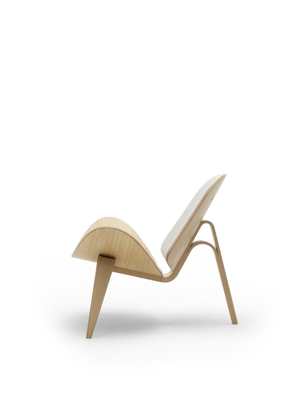 The public was initially reluctant to accept the Three-Legged Shell Chair (1963), an edgier piece of work, from Wegner, which debuted at the 1963  Furniture Guild Exhibition in Copenhagen, but has become more attracted to the wavy, airy design since the chair was reintroduced in 1998. Photo courtesy of Carl Hansen & Son.  Photo 6 of 9 in 8 Iconic Chairs by Hans Wegner