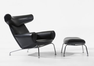 "Often referred to as one of the designer's favorite pieces, the leather Ox chair (1960), perched on chromed steel supports, shows modern design doesn't always need to be so ""dreadfully serious."" The inflated shapes of Picasso's paintings supposedly inspired the shape of this piece, which -- true to form if you're taking Surrealism as a reference point -- initially were sold with or without horns."