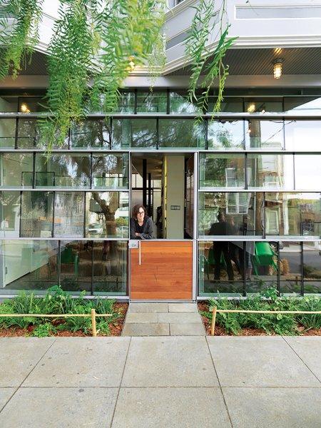 Dunbar and Astrakhan's low-cost, high-impact tour de force is a storefront facade constructed from salvaged double-insulated window glass panels arranged in a shingle pattern.  Photo 7 of 9 in Just Redo It