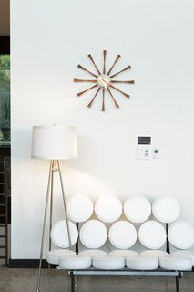 A vintage lamp and George Nelson's Marshmallow sofa and Spindle clock embody the mid-century feel of Soheil and Nima Nakhshab's design for a California family home.