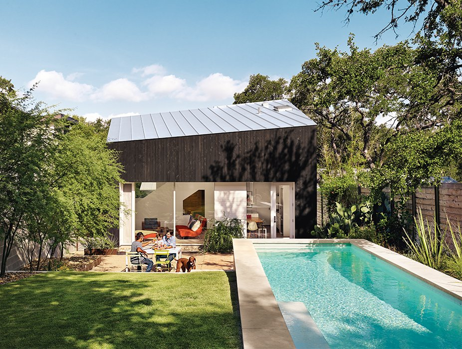 Outdoor, Back Yard, Small Pools, Tubs, Shower, and Grass Shah, Suttles, and their daughter, Tesla, use their outdoor space as an extra room. Near the pool is a seating area with Bistro chairs from Fermob.  Photo 3 of 12 in 1920s Bungalow Plus Modern Addition Equals Perfect Austin Home