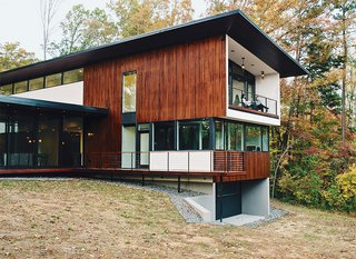 Floors are sealed and waxed concrete. The 4,200-square-foot home is clad in stained local tongue-in-groove cypress.