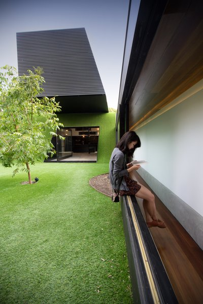 Architect Andrew Maynard designed this home in Melbourne, Australia. Called the Hill House, its form is defined by a cantilevered box that juts over an Astroturf-clad hill. A three-foot-wide corridor opens up to an expansive, open courtyard that draws sunlight into the property.