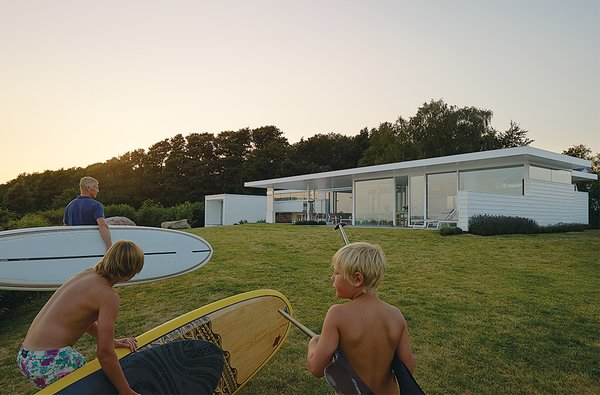 """A thoroughly modern """"surf shack"""" off the coast of southwestern Sweden was built for a family of avid water-sportsmen."""