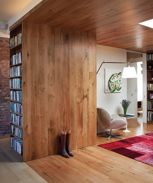 """Chair """"It was a natural choice,"""" says Adrian of using reclaimed and rescued wood. """"I didn't want to chop down a whole lot of trees."""" The walls and ceiling are lined with planks of butternut harvested from diseased trees in Vermont.  Photo 2 of 9 in In the Loop"""