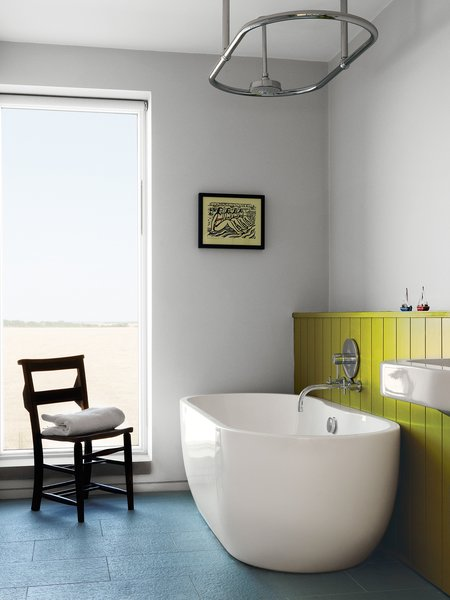 """A Lisbon freestanding tub and """"a church chair from a junk shop"""" complete the children's bathroom."""