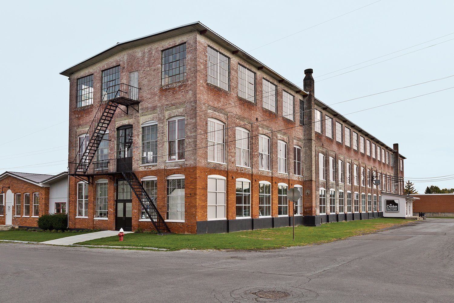 A 19th-century New York factory houses both Brandon and Amy Phillips's apartment and the workshop for their company, Miles & May Furniture Works.  Photo 1 of 7 in A Design Duo Takes Over A Whole Factory