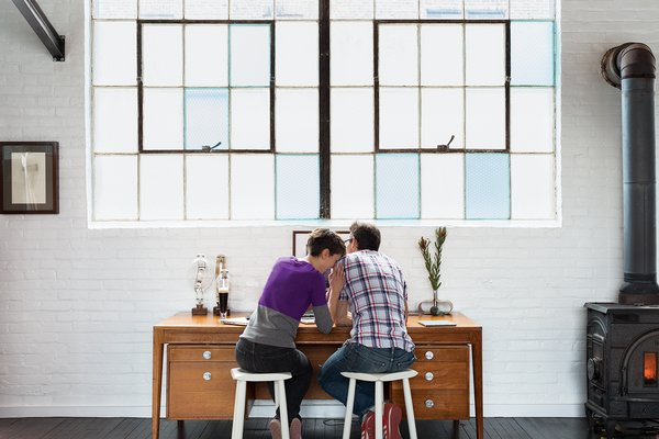 Brandon and Amy set up different workstations in the living area.  Photo 4 of 7 in A Design Duo Takes Over A Whole Factory