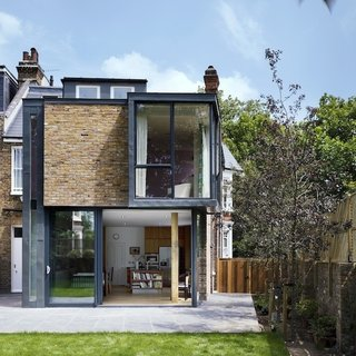 "Modern Renovation of a Classic London Home - Photo 1 of 6 - Milman Road Renovation<br><br>""What struck us as funny was the corner bay window,"" says architect Oliver Barsoum. ""It's almost like you're surrounded by glass on all sides. That's where the project began."" The vision became playing with and pushing that window into three dimensions.<br><br>Photos by Syte Architecture"