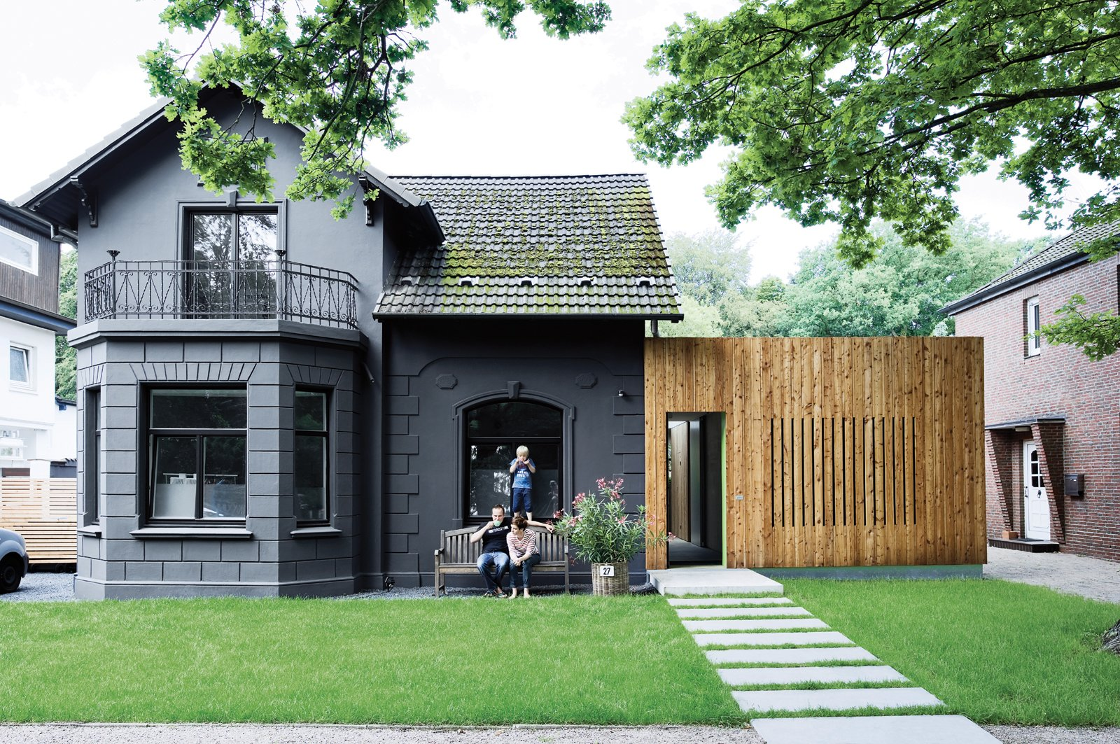 A family in Hamburg, Germany, turned a kitschy turn-of-the-century villa into a high-design home with a few exterior tricks, including sheathing the exterior in one-dimensional, murdered-out black. Tagged: Exterior, House, Wood Siding Material, Concrete Siding Material, and Shingles Roof Material.  Top Renovation Tips from the Pages of Dwell by Kelsey Keith from Paint it Black
