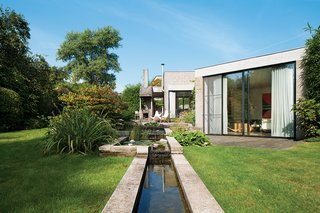 When Belgian fashion retailer Nathalie Vandemoortele was seeking a new nest for her brood, she stumbled upon a fortresslike house in the countryside designed in 1972 by a pair of Ghent architects, Johan Raman and Fritz Schaffrath. While the Brutalist concrete architecture and petite but lush gardens suited her tastes to a tee, the interiors needed a few updates.