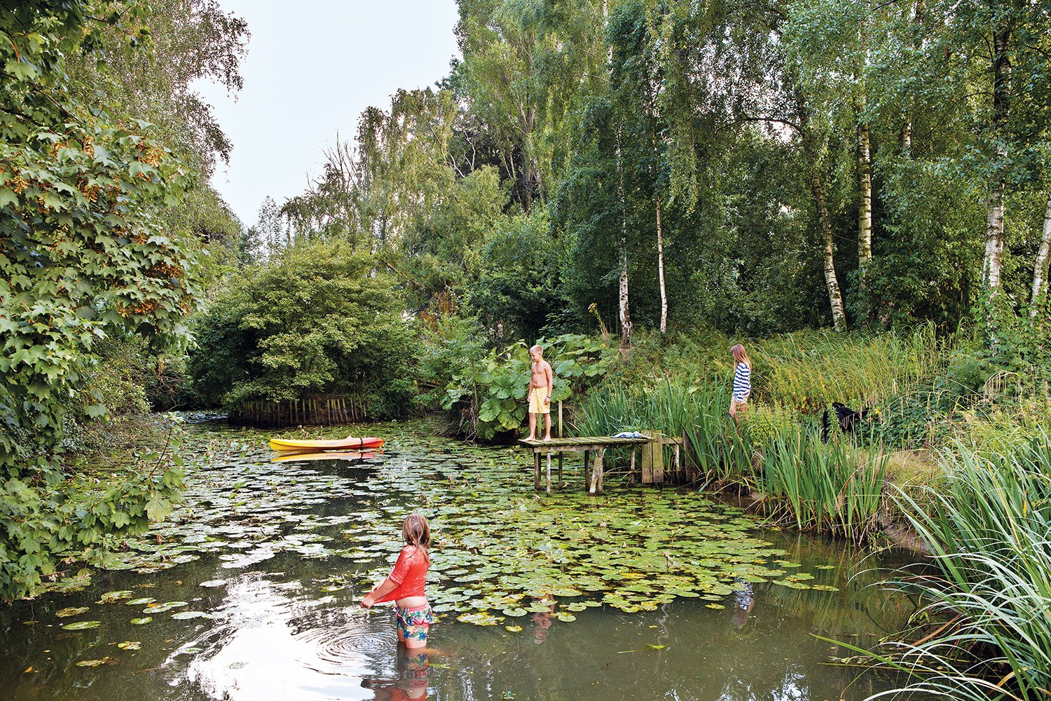 Outdoor Vandemoortele's young sons and their friends enjoy the house's nearly one-acre site as well, especially the lily pad–stocked pond.  Photo 6 of 9 in A Concrete Home in Rural Belgium