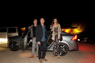 Dwell Media and Volvo Cars Bring The Future of Mobility to Palm Springs Modernism Week 2014 - Photo 8 of 11 - NORM designer and architect Kasper Rønn, shft.com founder Peter Glatzer, and Maria Margarita Chon exit a Volvo S60 as they arrive at the Marmol Radziner Desert Prefab for dinner.