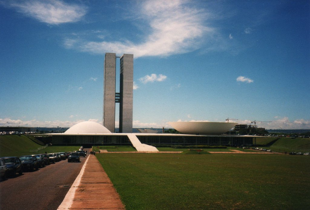Brazilian National Congress   Brasilia, Brazil (1964)  One of Niemeyer's numerous contributions to Brasilia, the custom-built capital created out of thin air in the '60s, the National Congress building symbolizes the working of the legislative branch; two semicircles, one for the Congress and one for the Senate, are divided by twin office towers. Photo by David Holt.  Photo 2 of 10 in Design Icon: Oscar Niemeyer