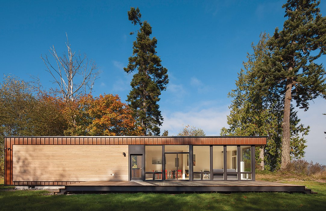 """Exterior, Wood Siding Material, Glass Siding Material, Prefab Building Type, Metal Siding Material, and Flat RoofLine Architect Chris Pardo designed the Element 1 model for prefab builder Method Homes, cladding it in Cor-Ten steel and cedar. Pardo's design """"is the definition of simple, elegant, straightforward building,"""" resident Karen Kiest says.  Photo 4 of 10 in 10 Steel Prefabs That Are Both Modern and Practical from Compact, Light-Filled Prefab"""