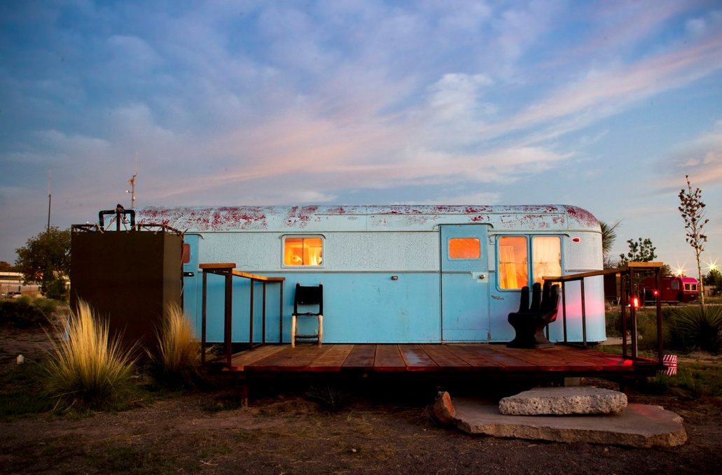 Exterior, Metal Siding Material, and Camper Building Type A sky-blue vintage trailer blends in with the sky.  Photo 4 of 9 in Hotels We Love: El Cosmico Hotel in Marfa, Texas