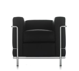 Grand Confort Armchair (1928)Inspired by a Maples club chair that caught Le Corbusier's eye, this cubical creation is one of Perriand's most famous designs. Decades later, it's still iconic, as anyone who's seen Maxell's famous ads from the '80s can attest. Photo courtesy of Cassina.