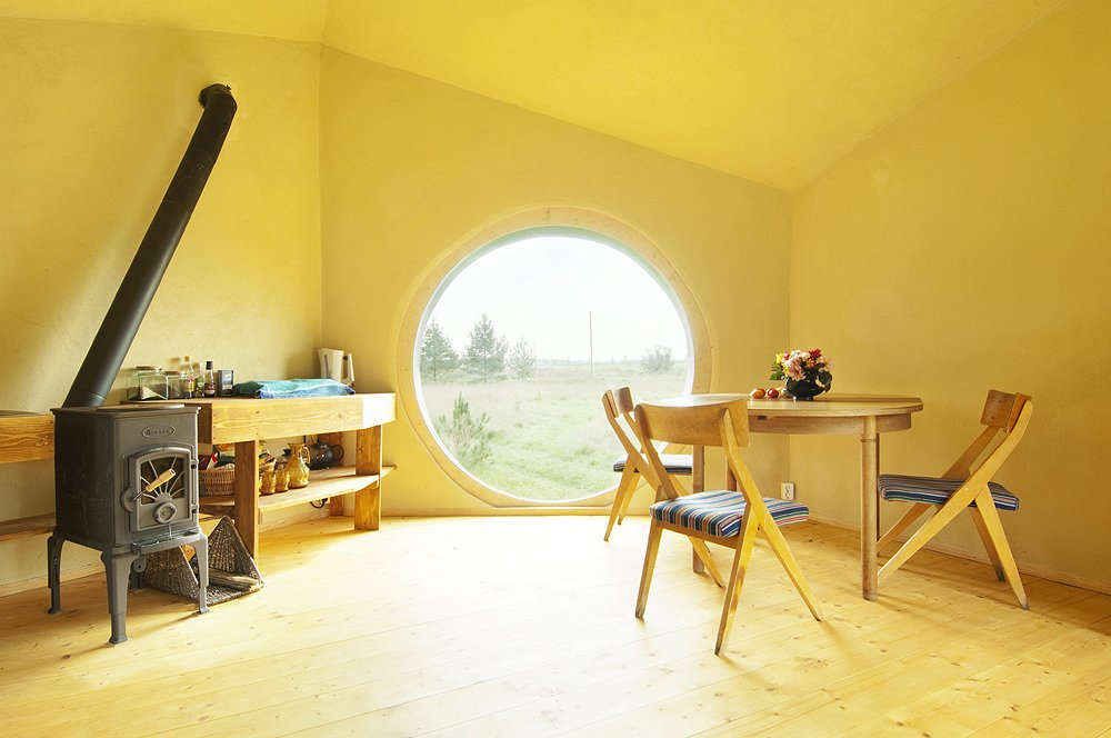 The interior of Jaanus Orgusaar's NOA cabin in the Virumaa region of Estonia. The unique shape of the dwelling creates a very open interior.  Photo 5 of 10 in Estonian Designer's Tiny Geometric Cabin