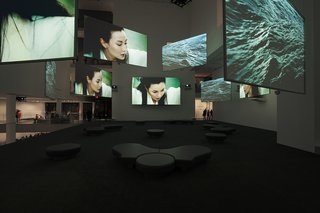 "Ten Thousand Waves, the nine-screen installation by Isaac Julien, pictured here while on display at the Museum of Modern Art, will be part of MOCAA's permanent collection and be featured in MOCAA's atrium. Other highlights include pieces from Africans from all over the continent and the diaspora, including work by Kudzanai Chiurai, Nandipha Mntambo, Edson Chagas, and Zanele Muholi. Mark Coetzee, the collection's curator, is originally from South Africa and says building a contemporary art museum in Africa is a dream come true. ""I've always wanted to do this since I was a kid,"" Coetzee says. ""Normally collectors collect what they collect, and at a certain point, they say 'Let's start a museum,'"" he says. By contrast, Jochen Zeitz gave Coetzee the go-ahead to build a collection with the scale and ambition for a museum from the outset.<br><br>Photo courtesy: Isaac Julien"