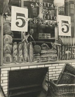 Berenice Abbott. Bread Store, 259 Bleecker Street, Manhattan, February 3, 1937 Gelatin silver print; printed c.1937