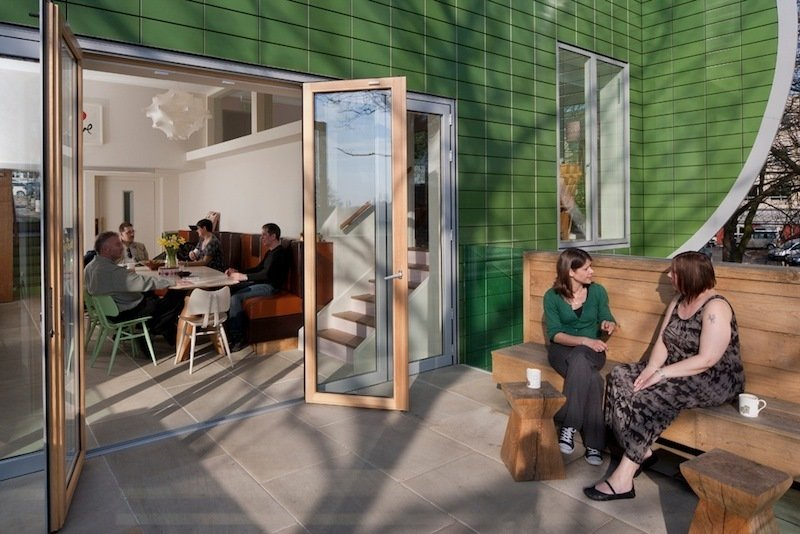 Nottingham kitchen and patio. Architect: Piers Gogh, CZWG Architects. © Martine Hamilton Knight.  Photo 6 of 14 in Maggie's Centres: A Blueprint for Cancer Care