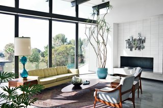 A Nelson sofa sits on a handmade Persian Mahi rug in the living room.