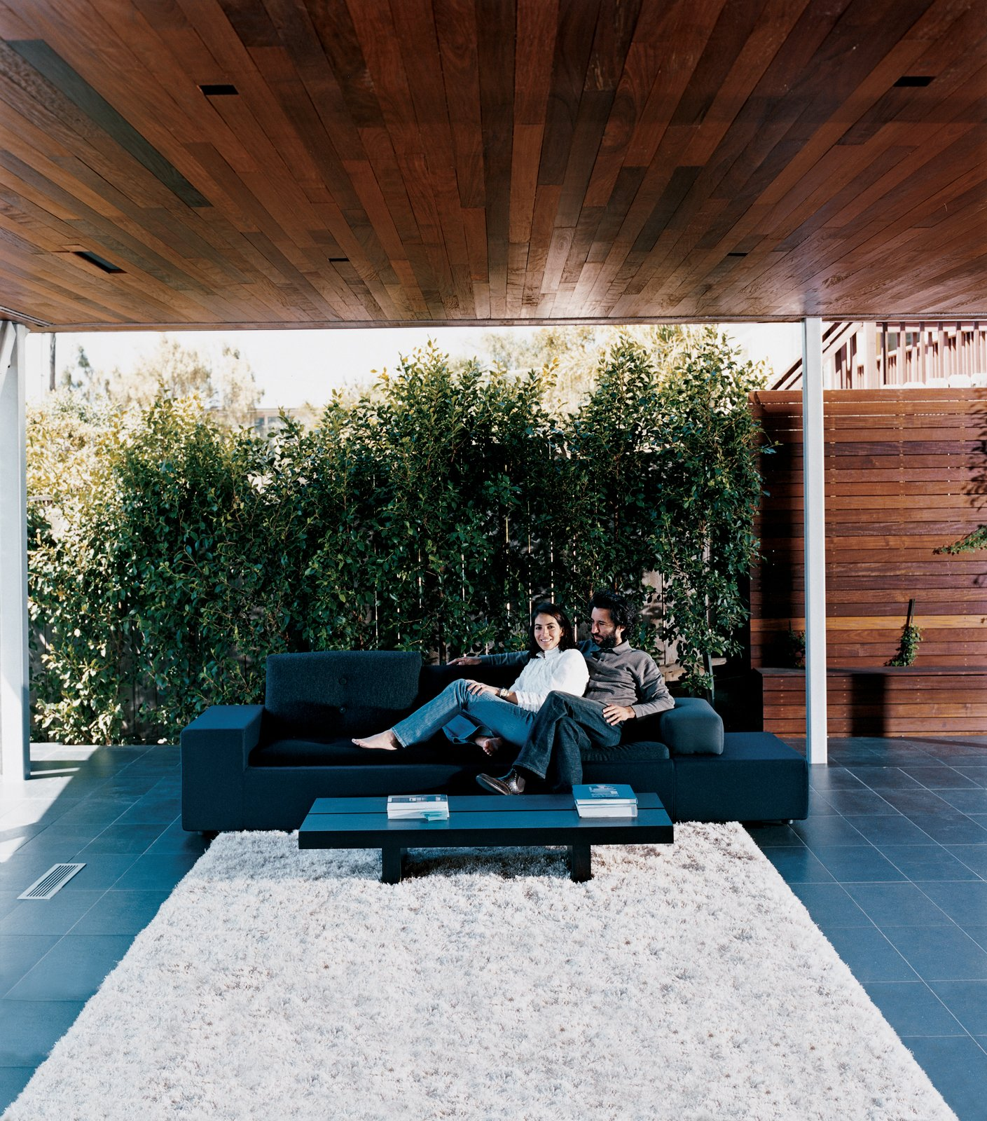 Modern home with Outdoor and Back Yard. Sebastian and Maricarmen take in the scenery from the comfort of their exposed living room. The couple sits on a Polder sofa by Hella Jongerius for Vitra. Photo  of Design Guide: San Diego