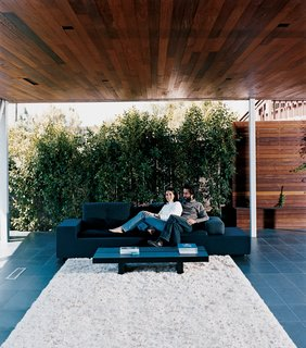 "Sebastian Mariscal's Wood Architecture - Photo 6 of 7 - Though he was born in Mexico City, San Diego–based designer and developer Sebastian Mariscal has readily absorbed this Californian obsession with deck life. A veteran of the local architecture scene, the 38-year-old Mariscal has designed a pair of identical houses called 2inns (pronounced ""twins"") on a La Jolla hillside overlooking the Pacific. Sebastian and Maricarmen take in the scenery from the comfort of their exposed living room, which employs all manner of hardwoods, local and exotic alike. Photo by Bryce Duffy."