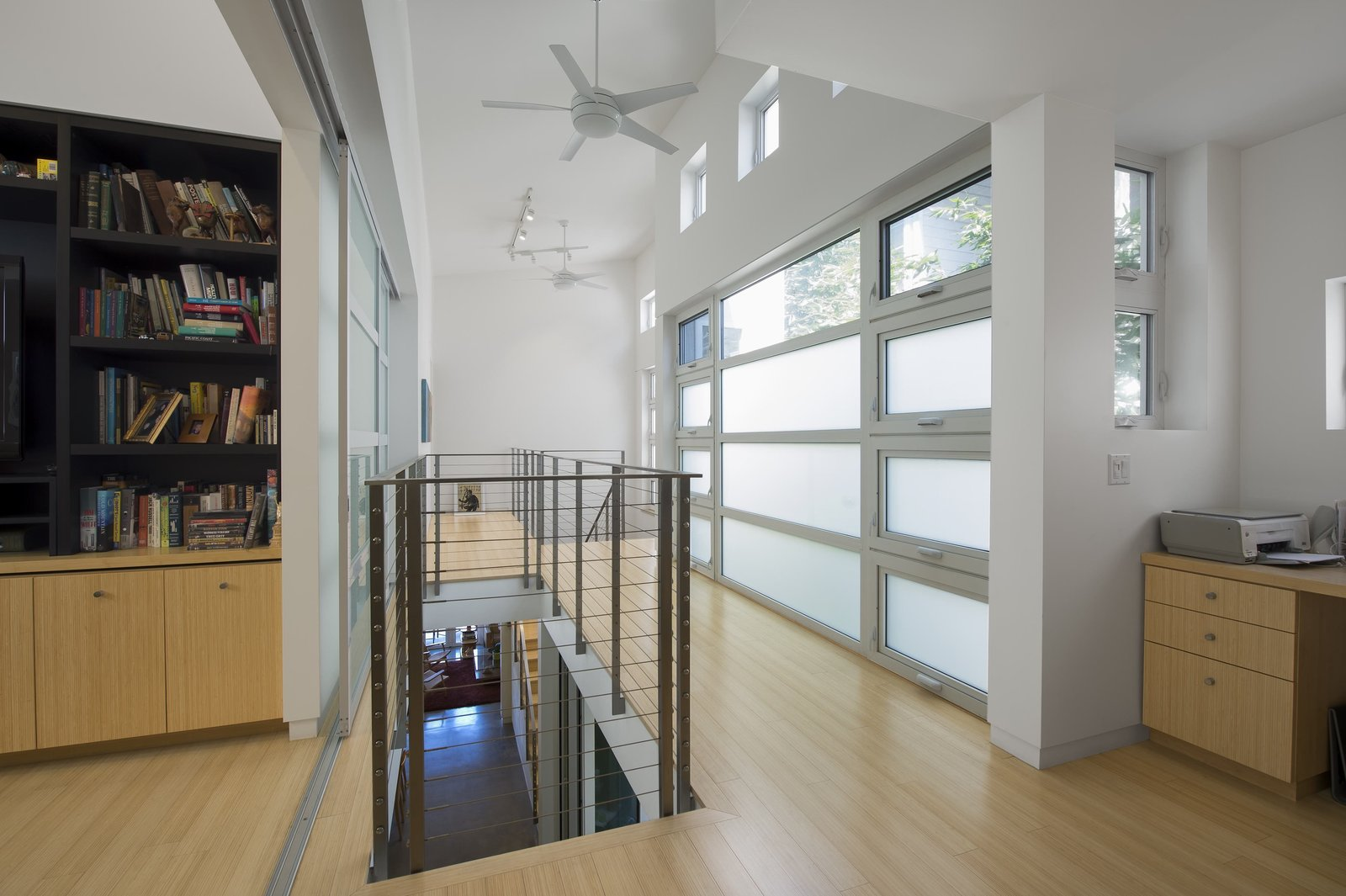 """Upstairs, passive ventilation gets an assist from high-efficiency Emerson ceiling fans. Photo by Ken Pagliaro Photography.  Photo 5 of 8 in A Sustainable """"Case Study"""" House in California"""
