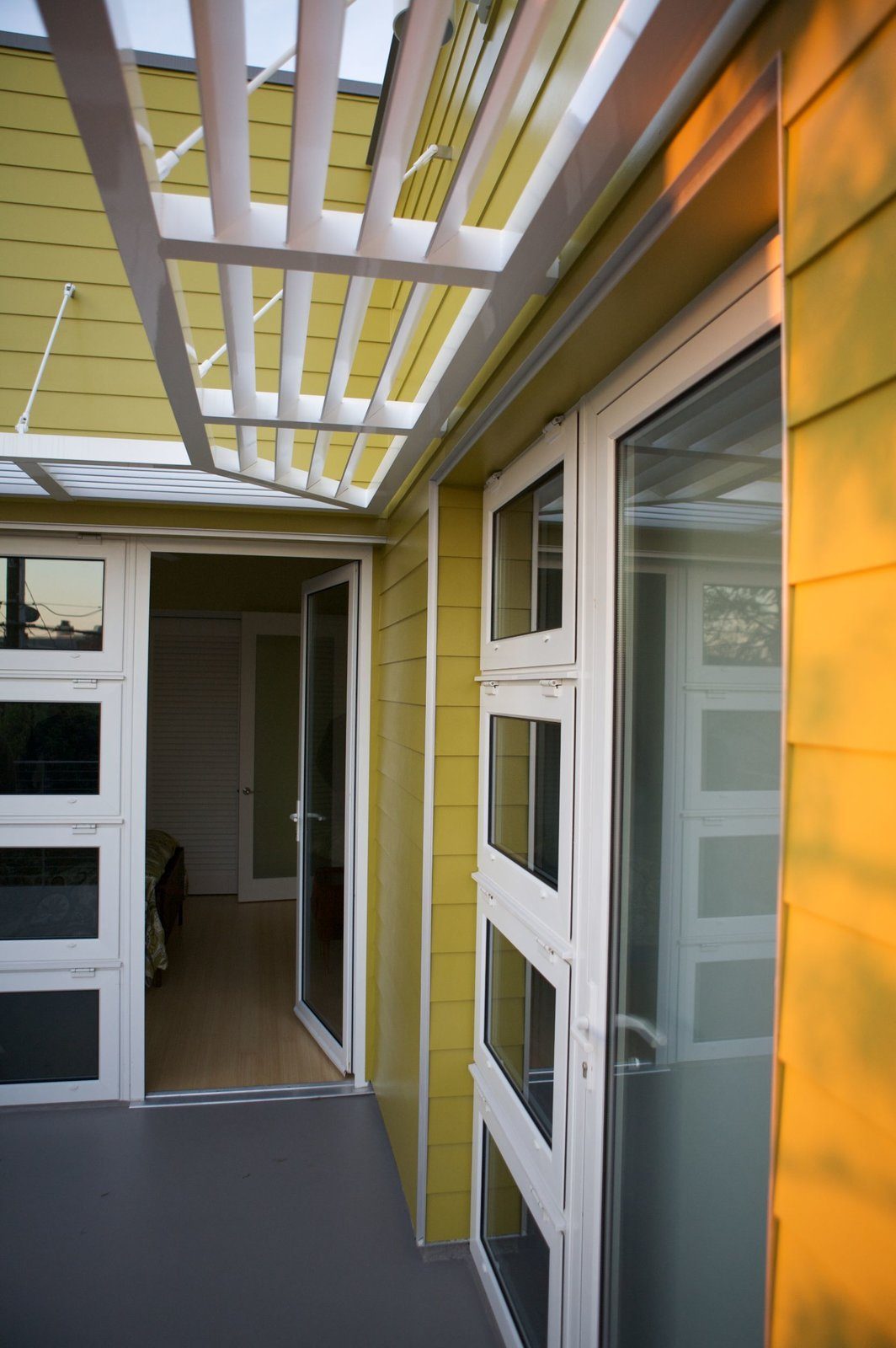 """Lap siding, a brise-soleil awning and white accents are reference the architectural vernacular of this coastal part of Southern California. Photo by Ken Pagliaro Photography.  Photo 8 of 8 in A Sustainable """"Case Study"""" House in California"""