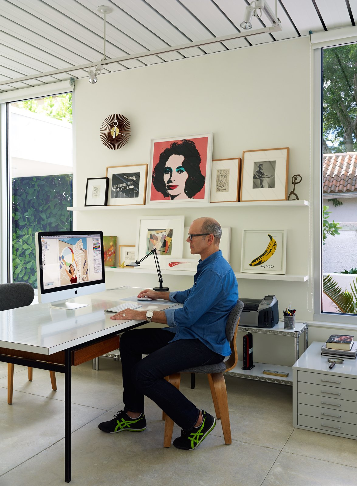 Office, Study Room Type, Chair, Lamps, Concrete Floor, Shelves, and Desk Pirman, an illustrator, works on a vintage Florence Knoll table in his studio at the front of the house.  Photo 6 of 13 in This Sparkling New Home Is a Perfect Remake of Classic Sarasota School Modernism