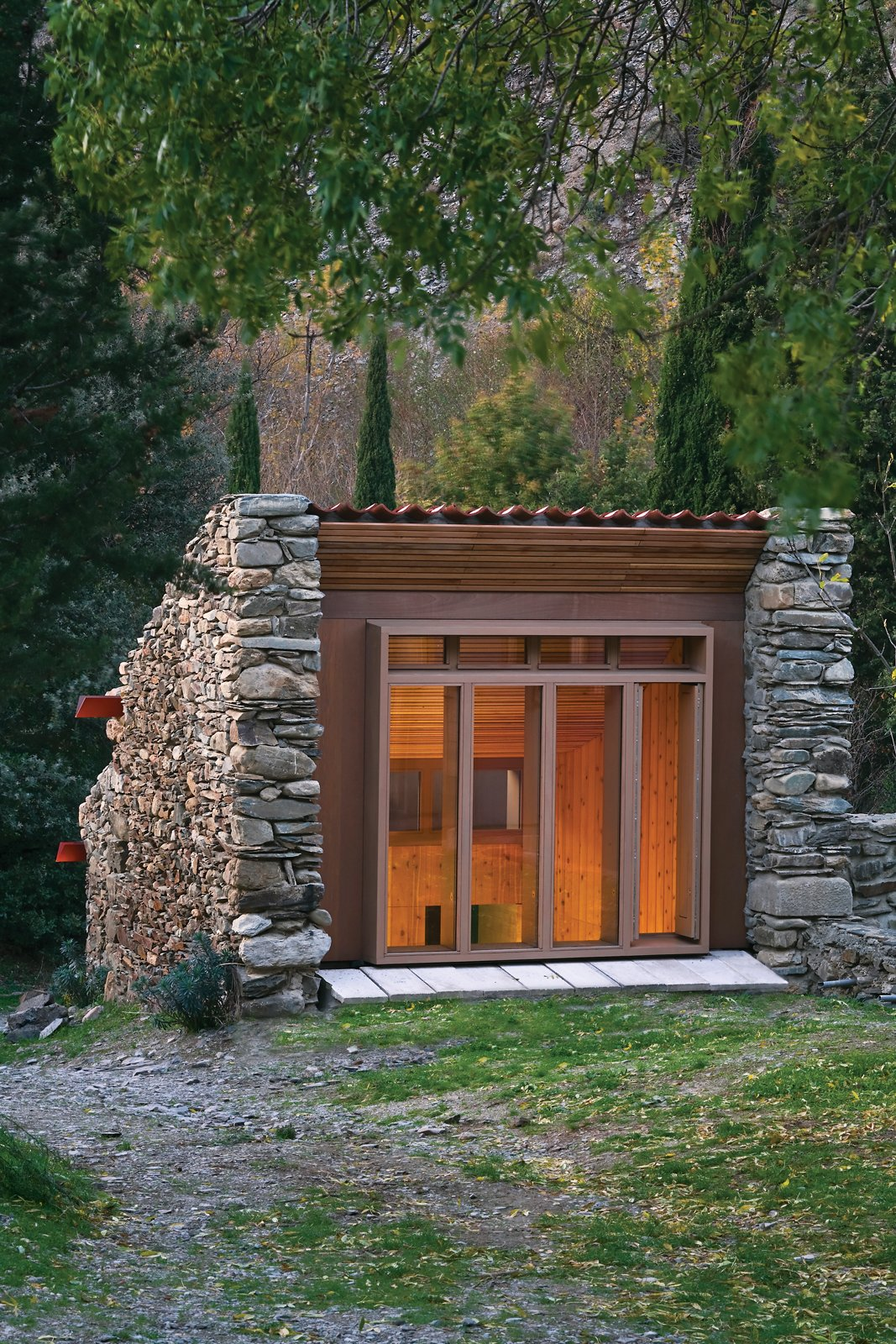 modern cabins wood and stone exterior