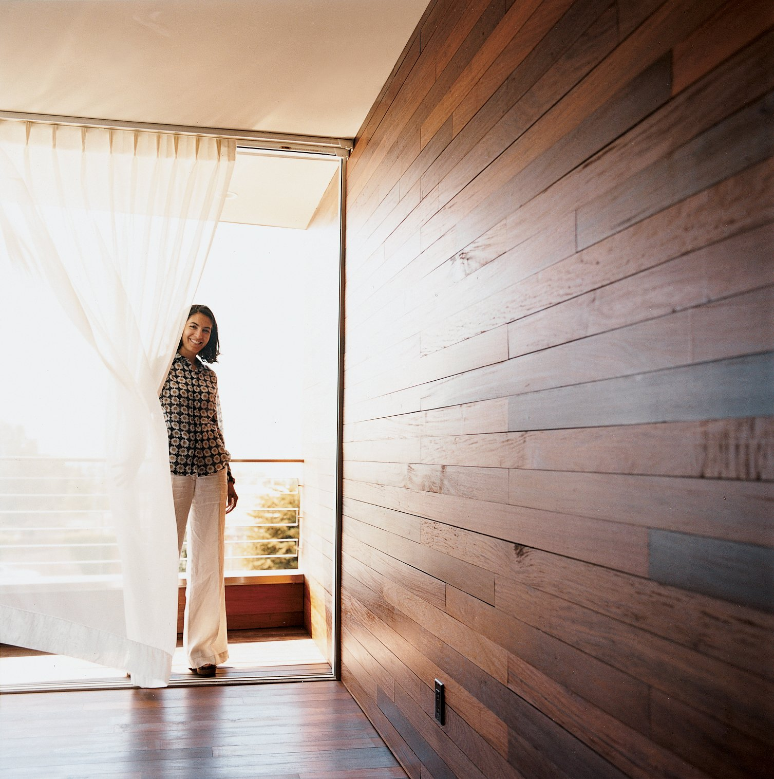 Doors and Exterior The Mariscals' bedroom opens out onto a small triangular patio. The exterior's ipe cladding also makes up the walls and floor of the master bedroom, further inviting the outside in.  Photo 7 of 7 in Sebastian Mariscal's Wood Architecture from Double the Pleasure