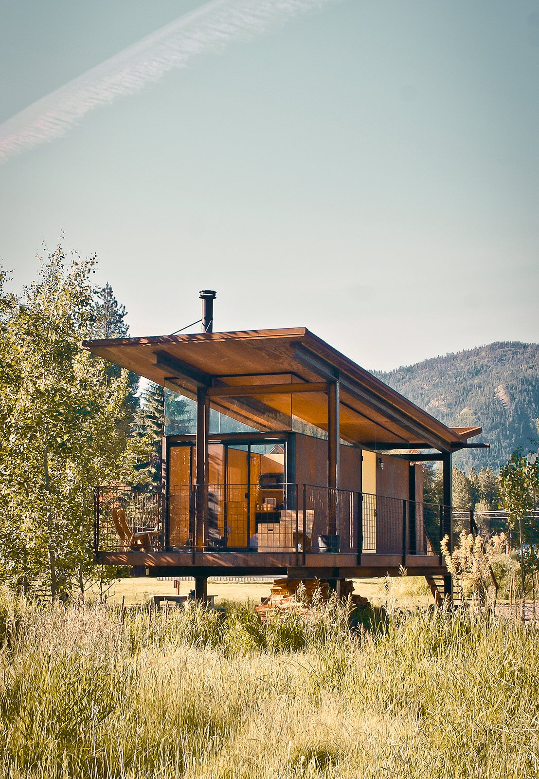 """Exterior, Cabin Building Type, Butterfly RoofLine, Metal Siding Material, Metal Roof Material, and Glass Siding Material The steel-clad Rolling Huts designed by Olson Kundig Architects in Manzama, Washington, sit lightly on the land thanks to wheels that allow the tiny residences to """"hover"""" above the site, optimizing views of the landscape. Photo by Derek Pirozzi.  Photo 83 of 101 in 101 Best Modern Cabins from Olson Kundig Houses"""