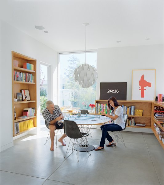 """The dining room is meant to be a flexible space for eating or dancing. """"One of the most important things for me,"""" explains Grunbaum, """"is how a house feels. It has to be a place where you don't want to leave."""" The Cyclone table is by Isamu Noguchi for Knoll and the pendant lamp is by Lightoiler."""