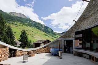 Villa Vals is subtly out carved from an alpine slope in Vals, Switzerland. The unique design by SeARCH and Christian Müller Architects provides both a comfortably sized patio and stunning mountain views while remaining visually unobtrusive in the pastoral landscape.