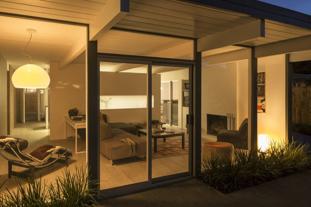 By night, the living room gives off light instead of taking it in. WAC Recessed lighting, as well as lamps by Vibia and Nelson Bubble softly illuminate the living space. Photo by: Scott Hargis  Photo 7 of 9 in A Renovated Eichler Home in San Rafael, California
