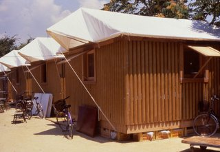 11 Buildings by Shigeru Ban - Photo 4 of 11 - Paper Log House (Kobe, Japan: 1995)<br><br>These 16-square-meter structures elegantly proved Ban's cardboard concept; tubing could be used as load-bearing structures, and could be made both waterproof and flame-resistant. Beer crates were used for support. Ban supposedly picked Kirin because the label colors were a better match. This design has since been used for disaster relief in India and Turkey.<br><br>Credit: Forgemind Archimedia, Creative Commons