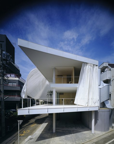 Curtain Wall House (Tokyo, Japan: 1995)  Taking the idea of an outer wall, and the concept of a shoji screen, to an extreme end, Ban wrapped the open triangular space of this contemporary home with large drapes, which provide an almost surreal quiet in and separation from the vast metropolis.  Credit: Forgemind Archimedia, Creative Commons  Photo 6 of 11 in 11 Buildings by Shigeru Ban