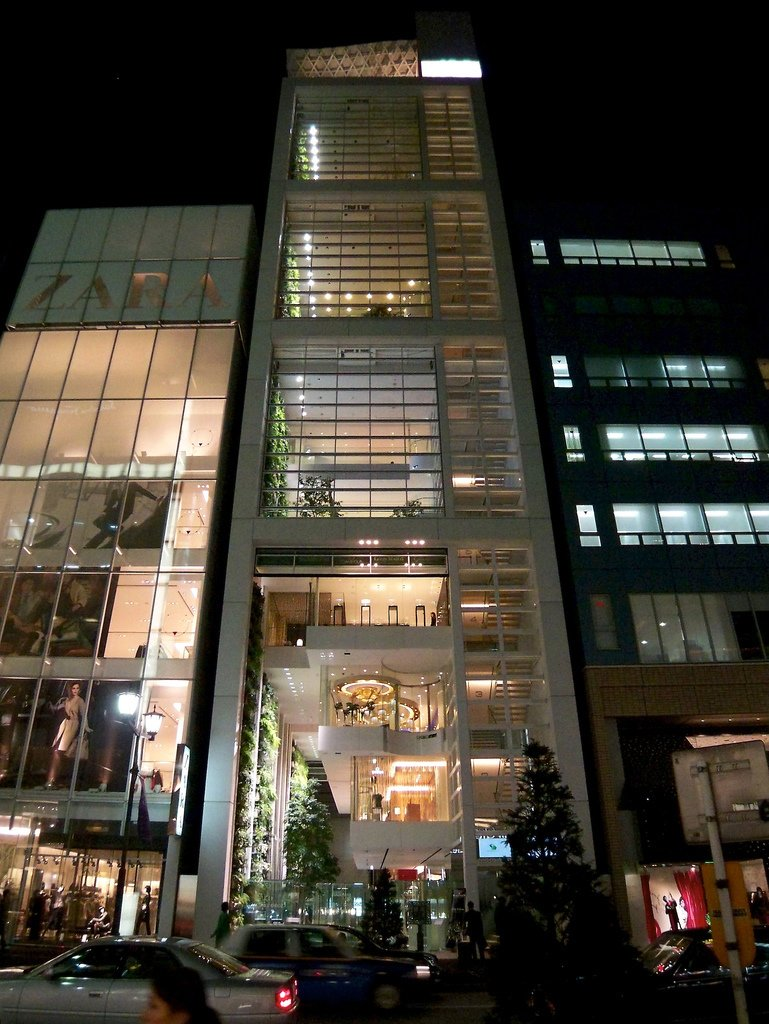 Nicolas G. Hayek Center (Tokyo, Japan: 2008)  How do you create retail frontage for seven different Swatch group brands when the building you're working with is only 56-feet wide? Shigeru Ban solved this challenge by stacking stores on top of each other in this Tokyo boutique, and then creating a small series of ground floor showrooms with individual elevators only linking to the specific brand. It's a structure that works like clockwork, a fitting design for the boutique watchmaker.  Photo 7 of 11 in 11 Buildings by Shigeru Ban