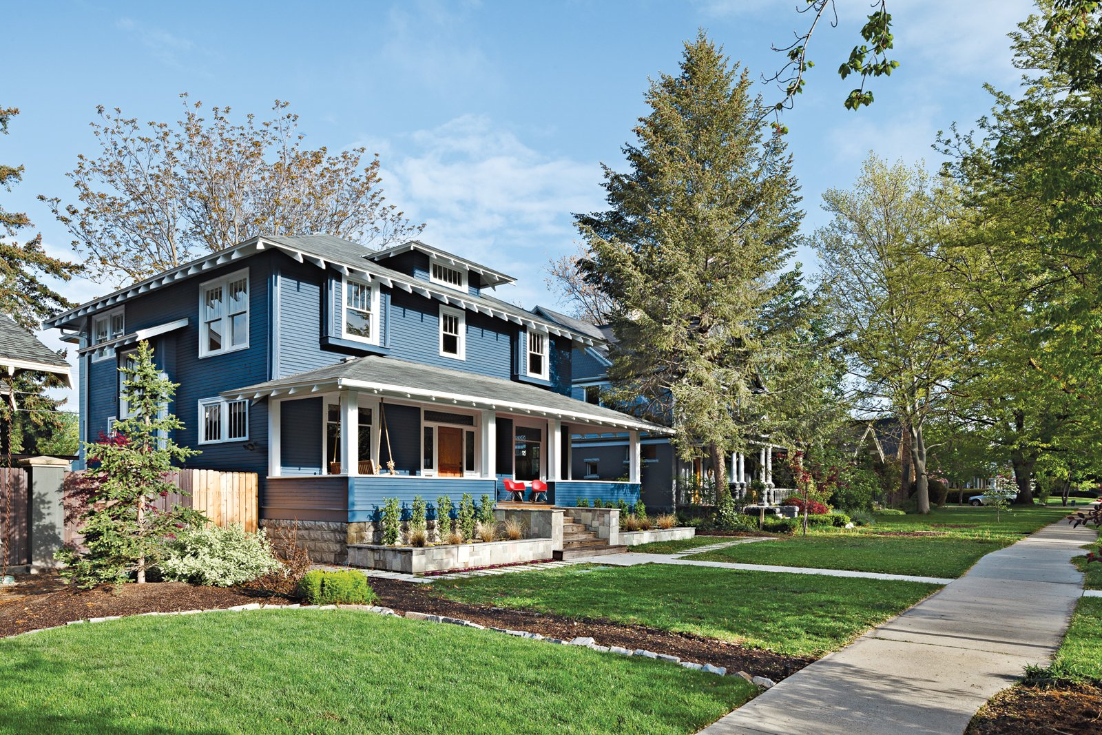 Exterior, House Building Type, Wood Siding Material, and Gable RoofLine The front of the 1910 house belies the modern extension architects Doug   Skidmore and Heidi Beebe created to   extend the family's living space.  Photo 5 of 11 in An Airy Addition to a Historic Boise Home